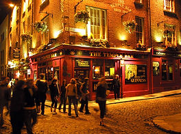 a throng of tourists around Temple Bar in Dublin