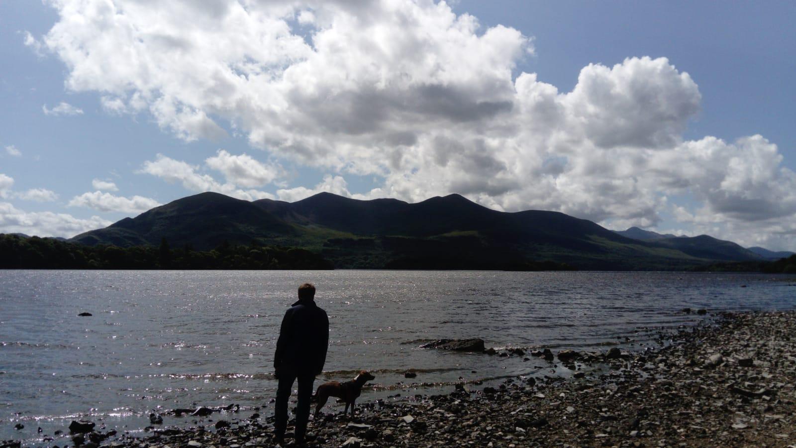 Man standing on Lake Leane shore