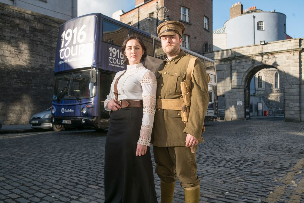 Guides in from of the 1916 tour bus