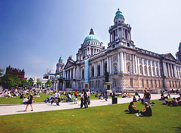 Belfast city hall with people on the lawn