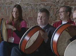 Group learning how to play bodhran