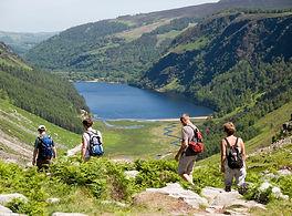 Hikers around upper Glendalough