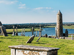 round tower and cemetery on River Shannon at Clonmacnoise