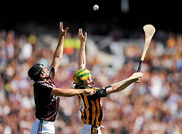 Two hurlers contest a high ball