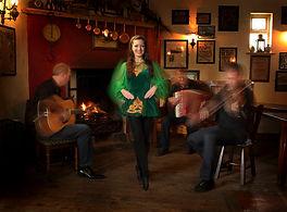 Irish dancer and trad band