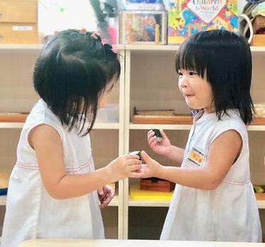 2 girls giving sushi.jpg