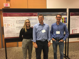 Zoe, Jarrod, and Nick at the CSC poster session (2019)