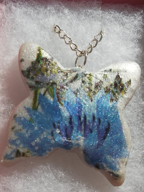 Artisan blue & white floral butterfly pendant