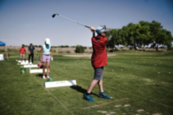 person-swinging-golf-club-on-field-13256