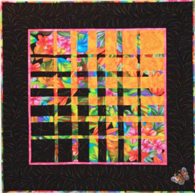 Tropical Garden convergence quilt with large bright flowers on black background