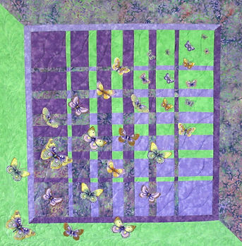 Butterfly Migration, convergence style quilt with 29 appliqued butterflies, purple and green fabrics