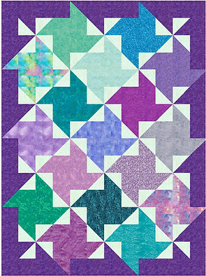 Paula's Puzzling Pinwheels, lap quilt with large colored pinwheels separated by small light pinwheels, puzzling because the points of the big pinwheels are in the block with the small pinwheels, concentration required