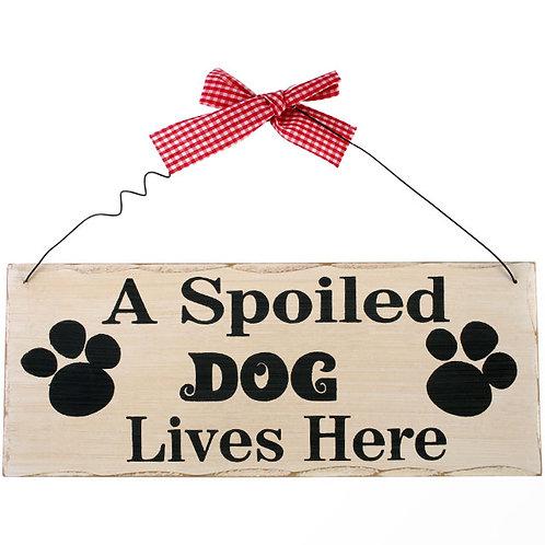 A spoiled dog plaque