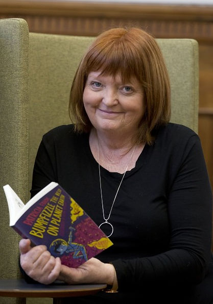 Author-smiling-with-book.jpg