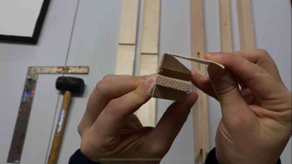 Every stretcher bar should have a bevel or a lip to prevent the painted side of the canvas from touching the stretcher bar.  Make sure that lip or bevel is placed against the canvas and the staples go in the flat, back side of the stretcher bar