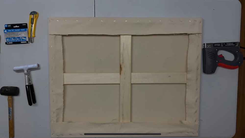 Many people remove too much material from the final stretched canvas, but if you have an issue, and need to restretch, its important to have enough material to work with