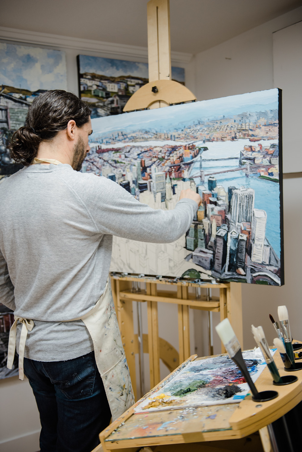 Mike Fantuz artist painting an aerial landscape of New York City with Palette Knife and Oil paint on canvas