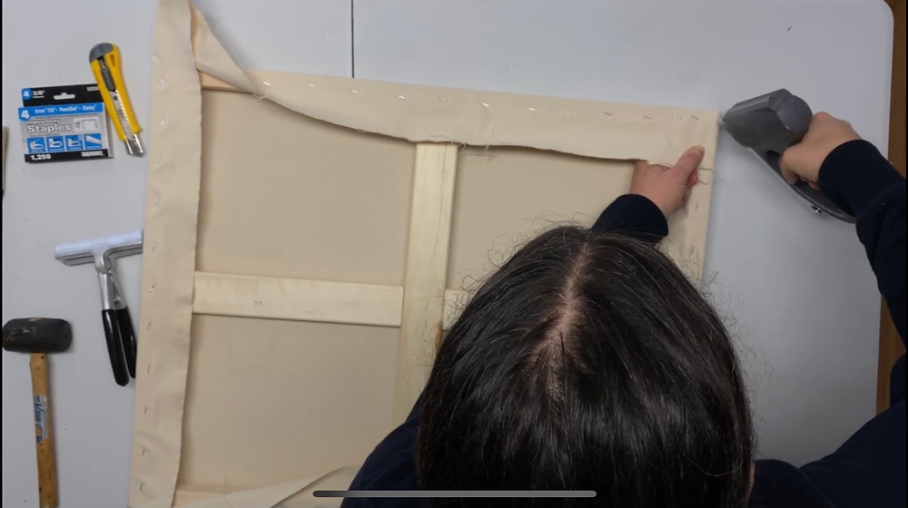 Avoid putting staples directly into the gap between the stretcher bars