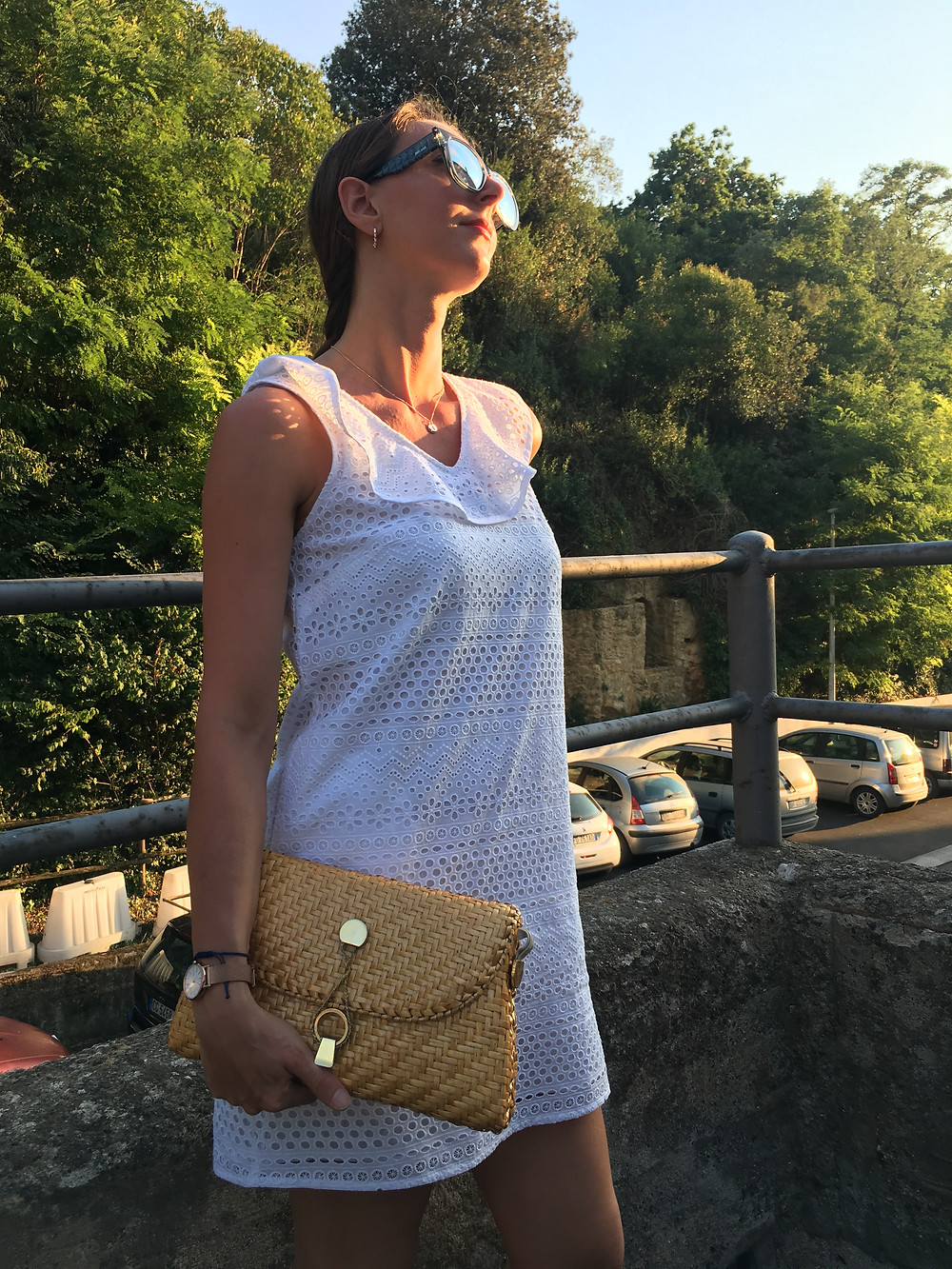 Ruffle embroidered white dress from Oliver Bonas, Missoma necklace, Astrid and Miyu earrings, vinatge clutch, Skagen watch, Just Cavalli sunglasses.