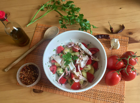 Potatoes, squids and tomatoes summer salad