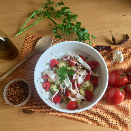 Healthy potato salad with squids and tomatoes