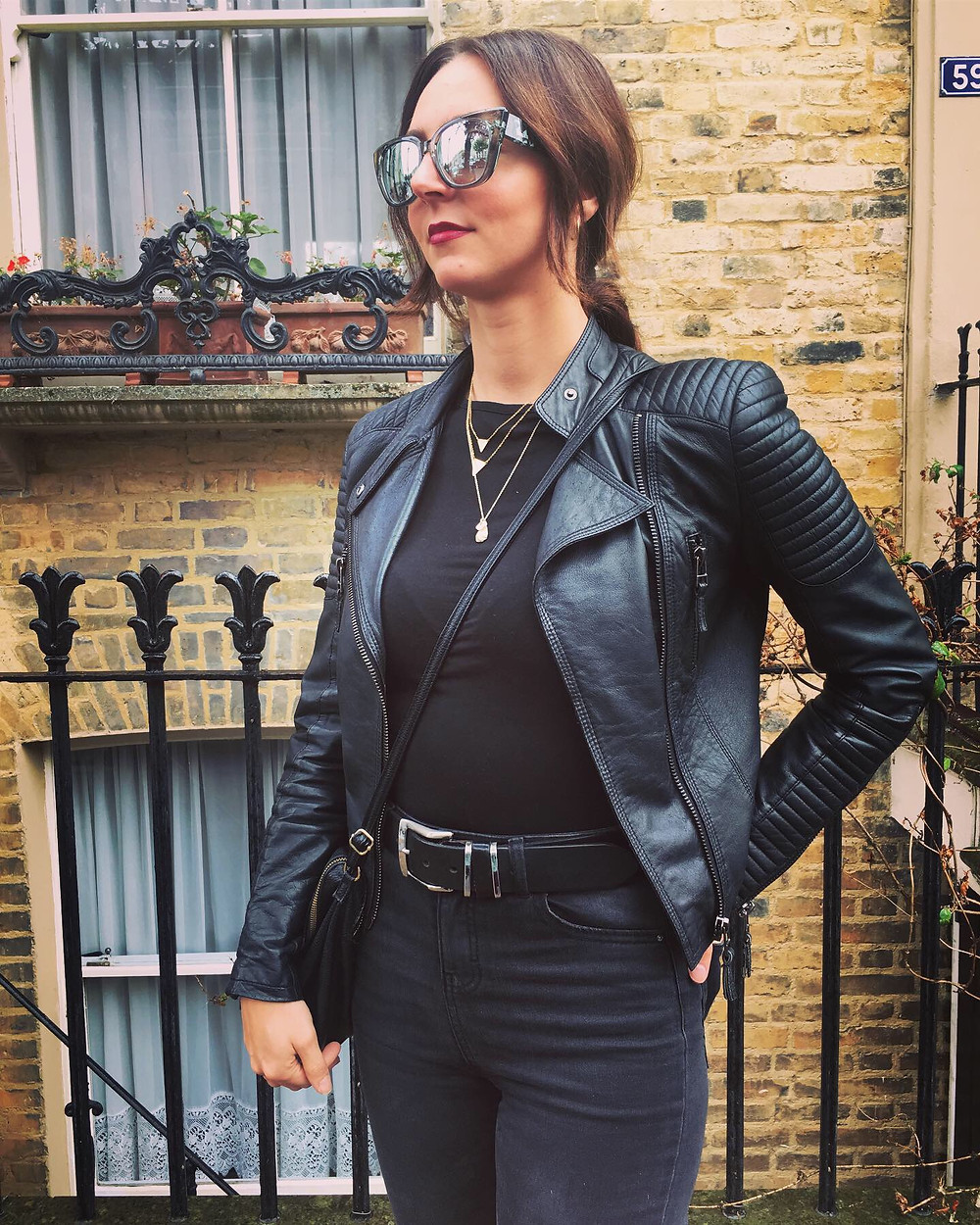 -Black leather jacket: Zara -Charcoal jeans: Primark - Sunglasses: Just Cavalli - Triangles necklace: Faye - Pebble necklace: Oliver Bonas