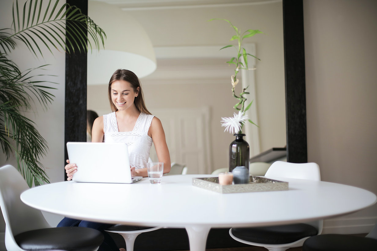 woman-in-white-sleeveless-dress-sitting-