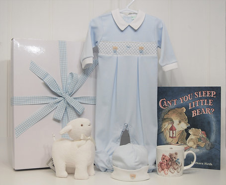 Blue smocked teddy with musical lamb.