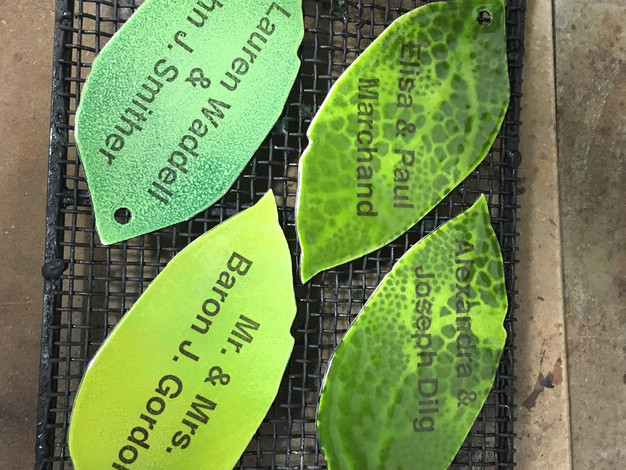 Enameled leaves withfired decal of donors