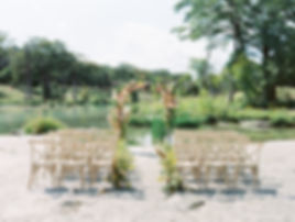 The Waters Point Wedding Venue in Wimberley, Texas. Riverfront ceremony site On the Rocks