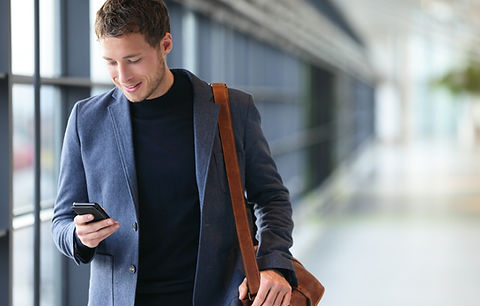 Man%2520on%2520smart%2520phone%2520-%2520young%2520business%2520man%2520in%2520airport.%2520Casual%2