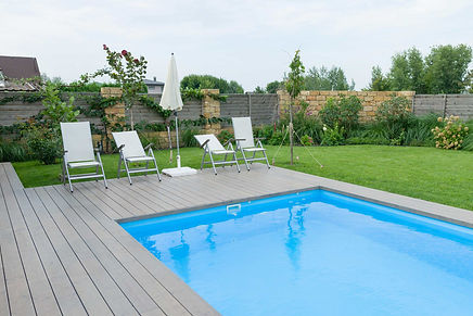 Stained-Decking-near-Pool-and-grass.jpg