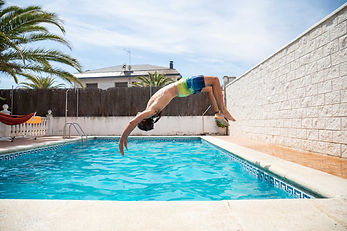 Man-backflipping-into-clean-blue-pool.jp