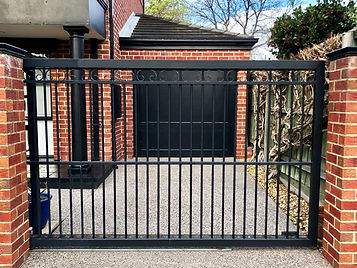 black-automatic-fence-for-driveway.jpg