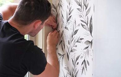 Bundaberg-painter-applying-wallpaper-to-
