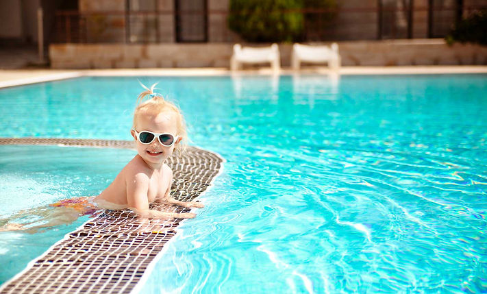 Baby-swimming-in-clean-pool-wearing-sung