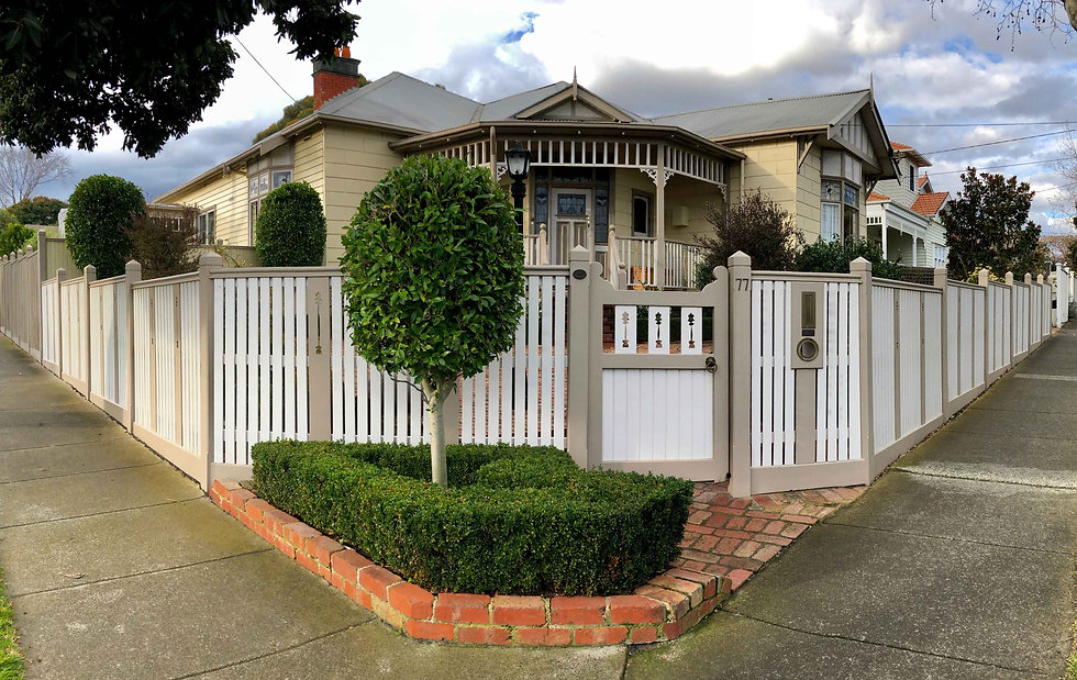 white-picket-fence-with-gate-freshly-pai