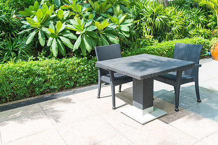 Tiled-ceramic-patio-with-woven-tables-ch