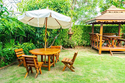 Wooden-Pergola-Tables-Charis-and-Umbrell