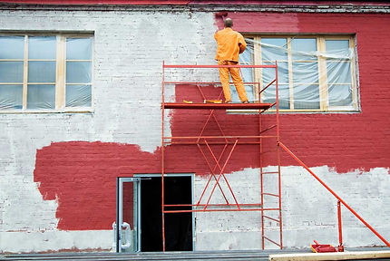 Exterior-brick-painter-with-ladder-and-r