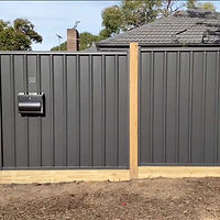Grey-colorbond-fence-with-stained-wooden