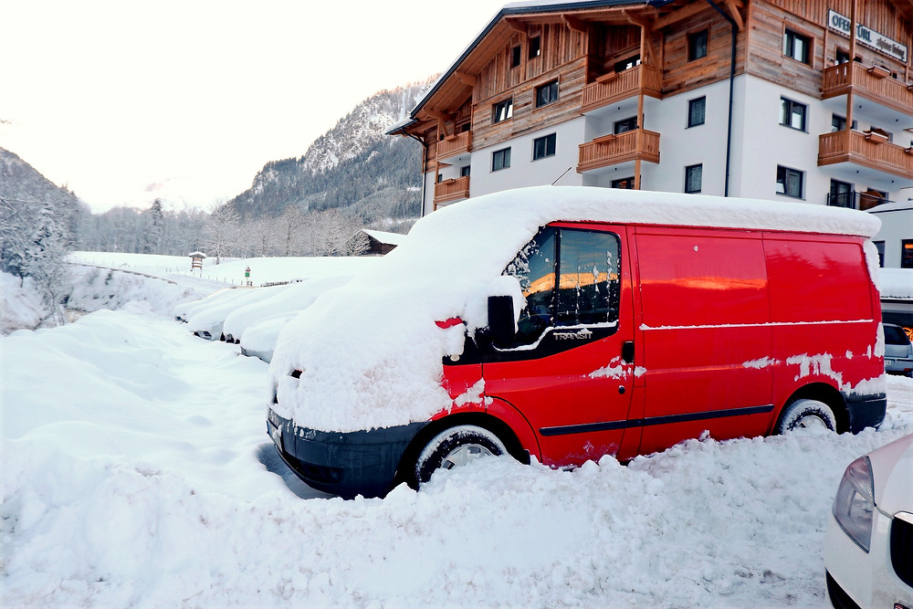 Our bright red bus parked in Flachau