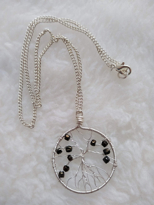 "silver 1.5"" pendant with black barrel beads on 18"" silver chain"