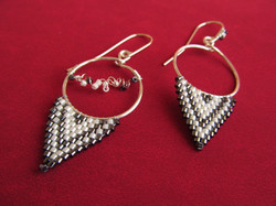 Gun metal and pearl glass on silver