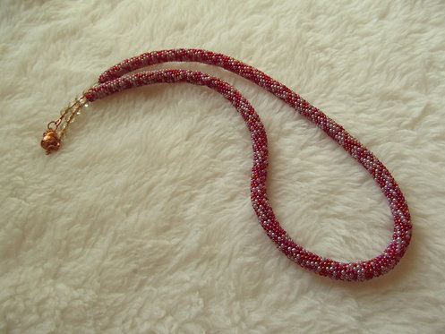 Handmade Necklace of iridescent raspberry and lavender