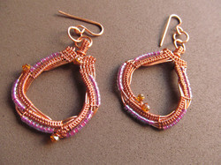 wire wrapped copper with lavender glass & amber crystals.