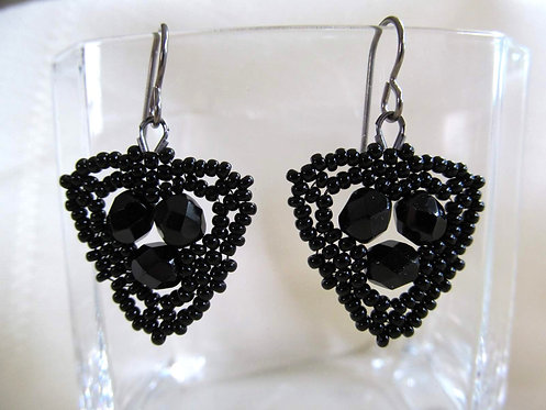 Handmade earrings of hand beaded black glass on titanium ear wires