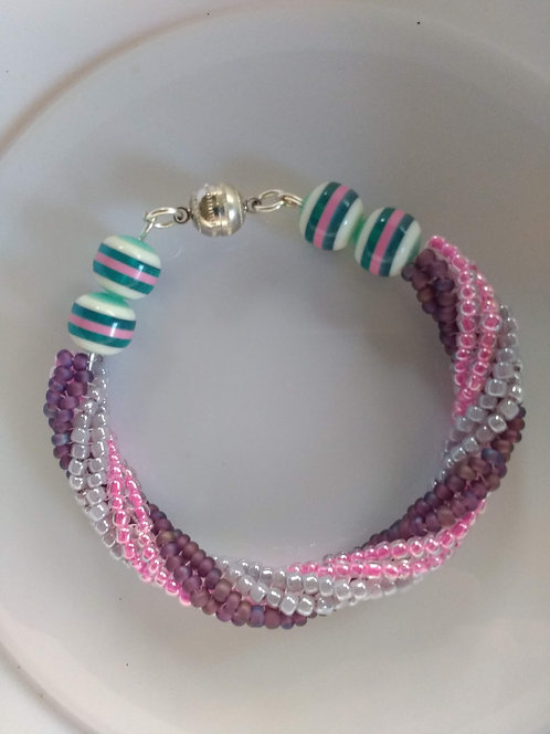 Handmade bracelet spiral of sparkly pink purples with silver magnet
