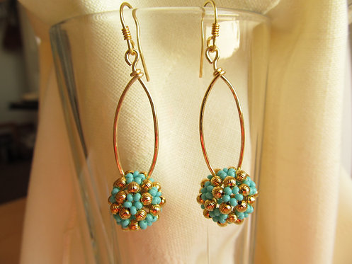 Handmade Earrings of hand beaded turquoise glass and gold plated brass