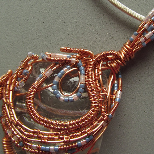 Handmade Necklace of wire wrapped glass in copper and blue